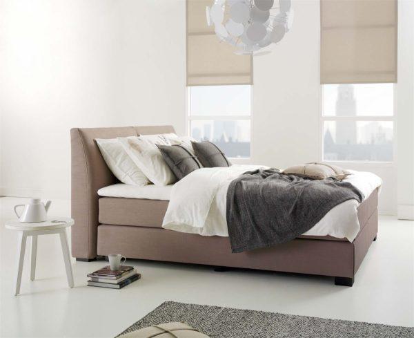 03: Boxspring-Bett 180 x 200 cm mit gebogenem Polsterkopfteil zum Anlehnen